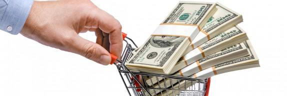 businessman's hand & steel grocery cart full of money stacks - i
